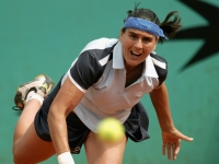 Conchita Martinez connects a throw during a game against Justine Henin