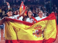 The Spanish team proudly celebrates with the Spanish flag