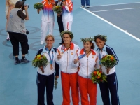 Conchita and Virginia silver medalist pose with Paola Suarez and Patricia Tarabini winning the bronze medal