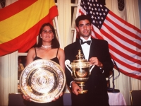 Conchita Martinez and Pete Sampras pose with their trophies at the champions dinner at the Savoy Hotel in London