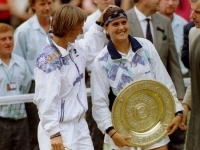 Martina with loving gesture but was deprived of her tenth title at Wimbledon by Conchita