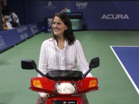 Conchita in San Diego, one of her favorite tournaments, is honored for his retirement in the competition and receives a hand scooter from the tournament organizers