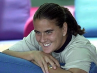 Conchita smiling in the players room waiting for her match